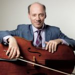 Clive Greensmith holding a cello and bow